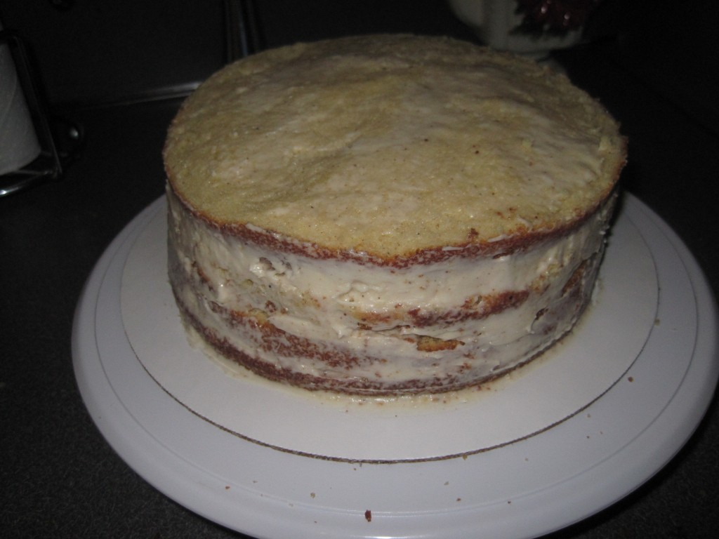 A crumb coat. Note the side has a little thicker frosting to fill in the gaps between the layers of cake.